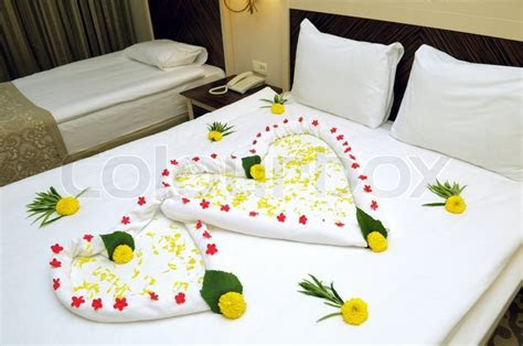 Bed Suite decorated with flowers and towels   Stock Photo