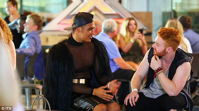 Forgetting the nerves: Earlier in the show, the singer was pictured enjoying a gossip with another contestant backstage