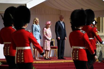 The Bidens meet with Queen Elizabeth at Windsor Castle.