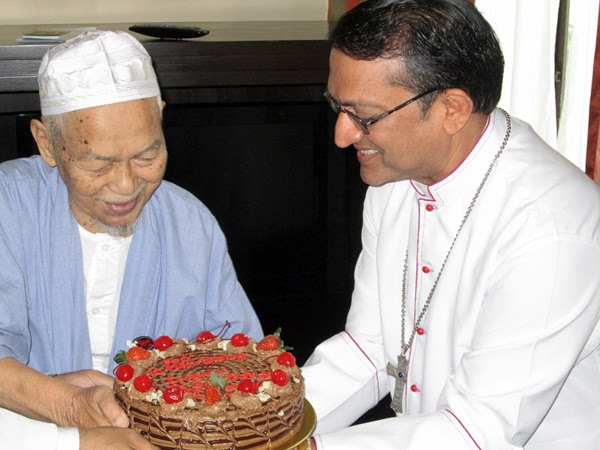 This one's from me to you: Tok Guru presents Bishop Sebastian with a mouth-watering cake