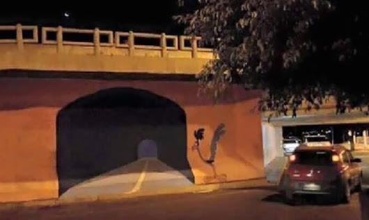 A Graffiti Artist Painted A Road Runner Tunnel On A Wall And Somebody Tried To Drive Through It