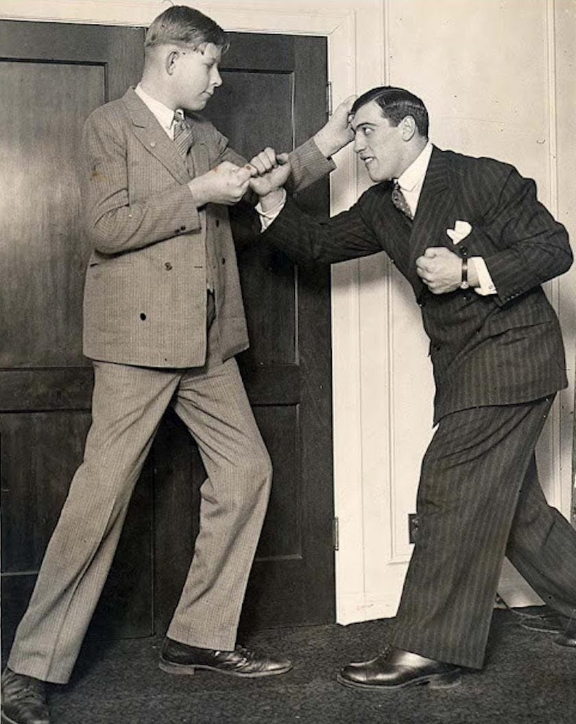 At age 12, Wadlow learned that he had a hyperactive pituitary gland that caused his incredible growth. In this photo, world heavyweight champion Primo Carnera playfully punches Wadlow, then 6-foot-11.