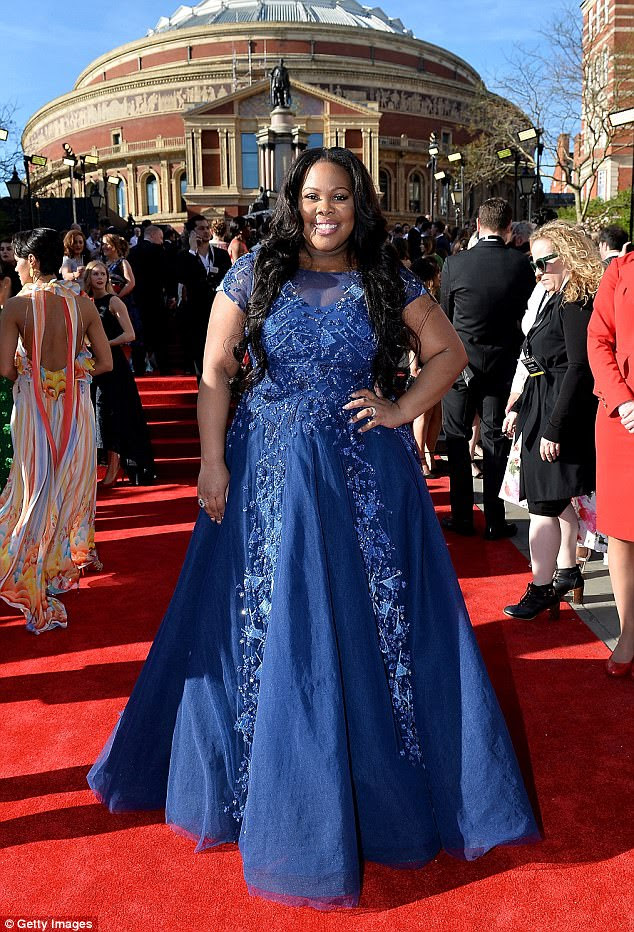 Brilliant in blue! The multi-talented star stood out from the crowd in the floor-length beaded gown with sheer neckline