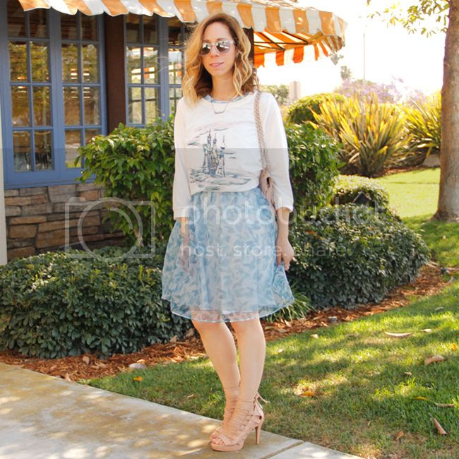 Fashion blogger The Key To Chic wears a LC Lauren Conrad for Kohl's Disney Cinderella collection sequin castle graphic sweatshirt and organza bow back dress.