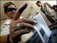 Iraqi voter, with purple ink on her finger to show she has voted