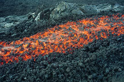 This is lava called aa lava.  A a lava is one of the three basic types of lava.  It is a basaltic lava that has a rough or rubbly surface and is made up by broken lava blocks called clinker. -- Sophia George