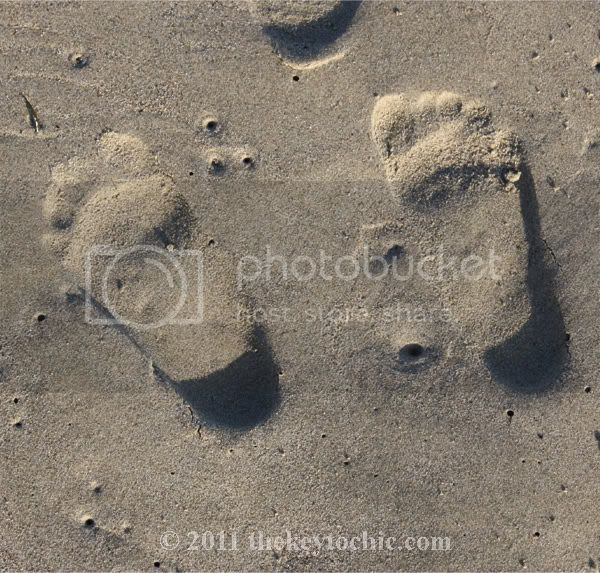 baby sand footprints
