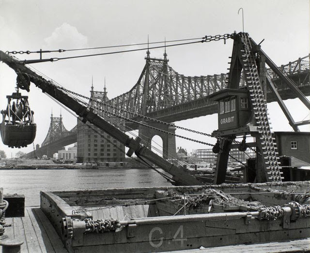 Queensboro Bridge: I. From 63rd Street Pier, Manhattan. Crane and pier in foreground, bridge, East River and Roosevelt Island beyond.