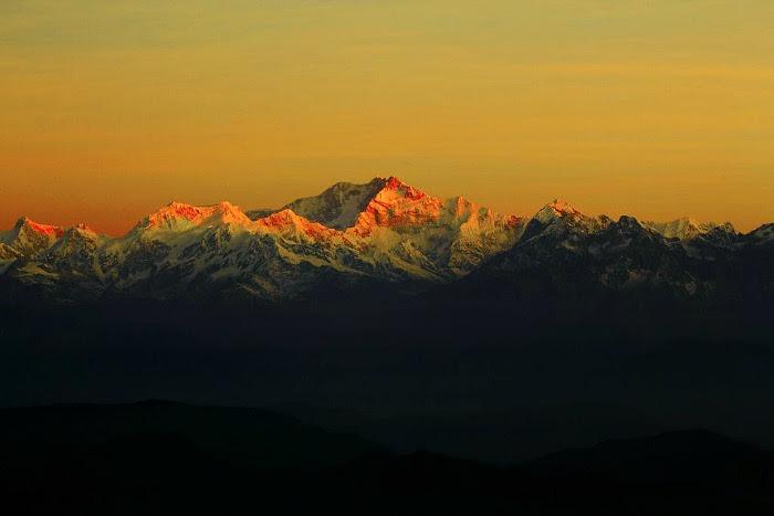 The breathtaking sunrise over the horizon of Khangchendzonga