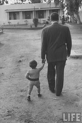 President Gamal Abdul Nasser at his home with his small son just after Port Said invasion.