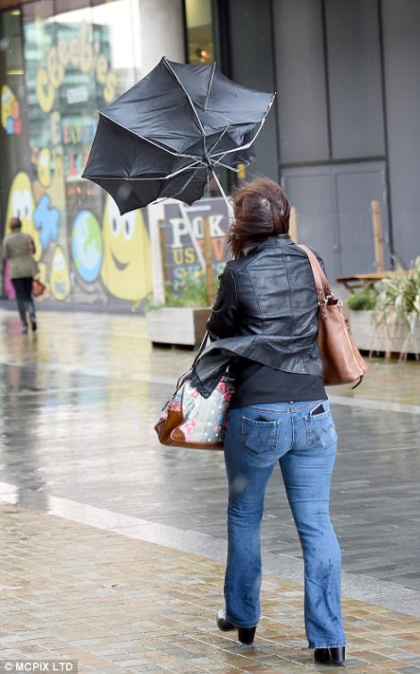Strong winds were turning people's umbrellas inside out