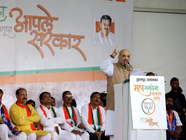 Union Home Minister Amit Shah addresses supporters during a campaign ahead of Maharashtra assembly polls, at Tuljapur in Osmanabad district. PTI