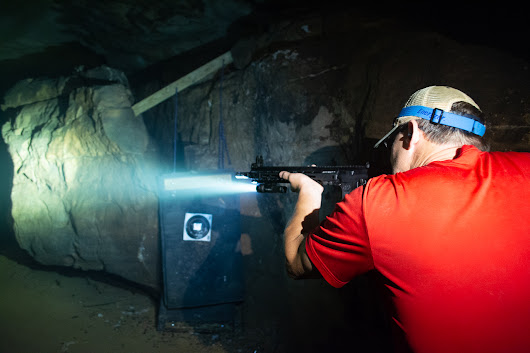 Illuminating a Black Hole with Crimson Trace Weapon Lights | OutdoorHub