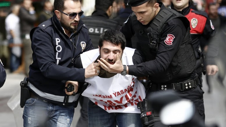 File Photo: Turkish riot police arrest a protester who tried to reach Taksim Square for a May Day celebration, in Istanbul, Turkey EPA, CEM TURKEL