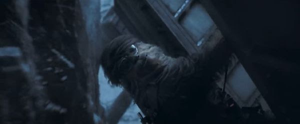 Chewbacca hangs on for deal life as the Conveyex skims the side of a mountain in SOLO: A STAR WARS STORY.
