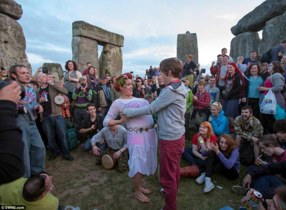 A couple of partygoers danced together in a rare chance to be among the Stonehenge stones