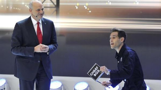 Protestor Jumps Into Volkswagen Auto Show Presentation With 'Cheat Box'