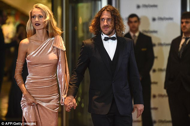 Former Barcelona captain Puyol holds hands with his stunning wife Vanessa Lorenzo