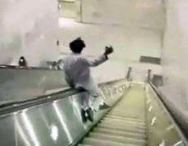 Man sliding down escalator