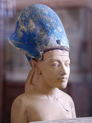 Small statue of Ahkenaten wearing the blue crown
