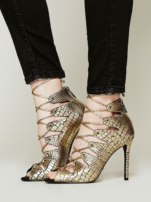 LE FASHION BLOG SHOE CRUSH GOLD PYTHON EMBOSSED SCHUTZ SLATE LACE UP HEEL HEELED SANDAL BLACK SKINNY JEANS 1 photo LEFASHIONBLOGSHOECRUSHGOLDSCHUTZSLATELACEUPHEEL1.jpg
