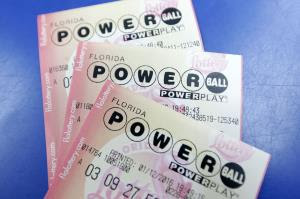 Purchased Powerball lottery tickets are shown Tuesday, Jan. 12, 2016, in Miami.