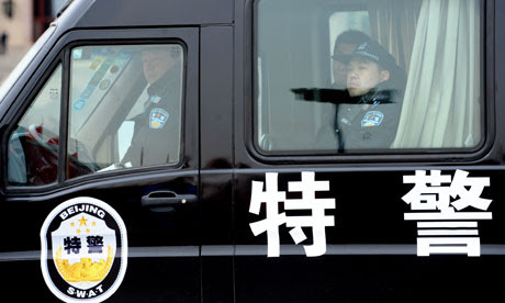 Chinese police keep watch on Tiananmen Square