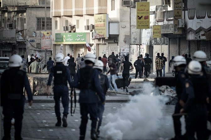 Riot police disperse protesters in the village of Daih, west of Bahrain's capital Manama, February 22, 2013