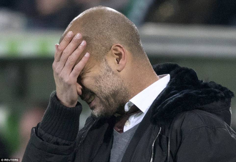 Pep Guardiola reacts during his side's 4-1 defeat against second-placed Wolfsburg