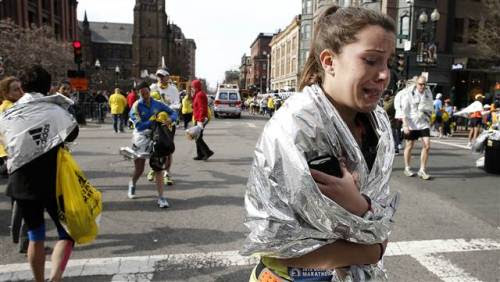 UPDATE: Three dead in Boston Marathon explosions, at least 100 injured  (Photo: Winslow Townson / AP) With thousands of runners still on the course, two bombs exploded near the finish line of the Boston Marathon on Monday, killing three people, injuring at least 113 and turning the city's most celebrated event into a grisly spectacle of shattered glass, blood and screams. More on this developing story.