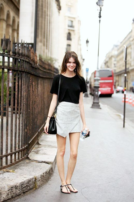 Le Fashion Blog Model Off Duty Street Style Vanessa Moody Black Tee Asymmetrical Wrap Skirt Embellished Flat Sandals Via Vogue Italy