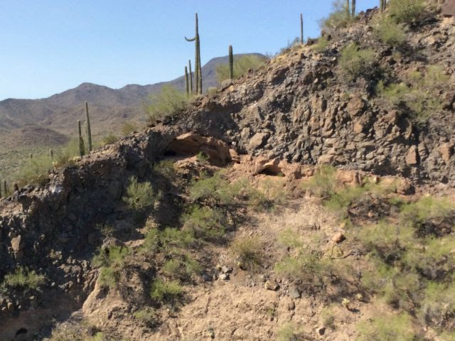 CAPTION FOR PHOTO: This photo is of a cave in which scouts for the Mexican drug cartels serve as outlooks for smugglers traversing through the valley down below. According to Sheriff Babeu and his pilot, this cave is about 68 to 70 miles inside the U.S. border with Mexico.