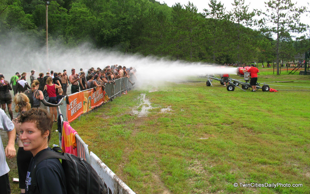 After running the Warrior Dash and swimming in the mud, you've got to clean up somehow. The best way was to head to the snow making machine, after all, we are on a ski slope. The water spray hurt when it hit your skin, but it did clean up the mud enough.