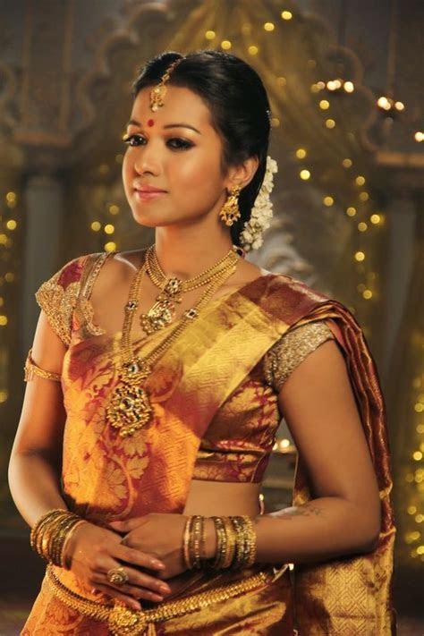 Maroon Golden color Silk Saree   Photo Gallery