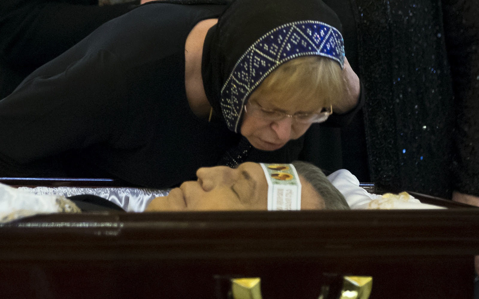 The widow of Andrei Karlov Marina kisses her husband during a religious service for killed Russian ambassador to Turkey, Andrei Karlov inside the Christ the Saviour Cathedral in Moscow, Russia, Thursday, Dec. 22, 2016.(AP/Alexander Zemlianichenko)