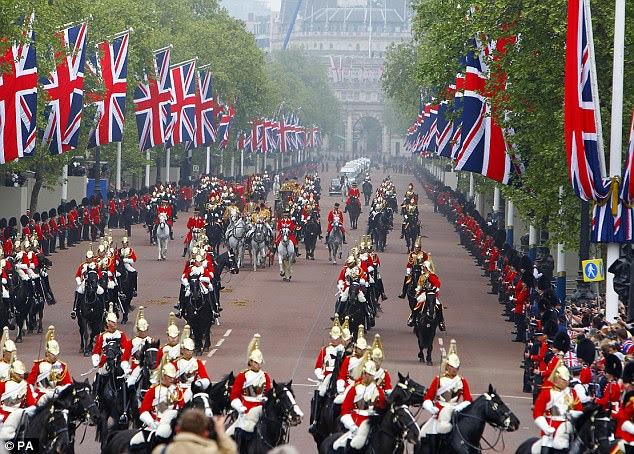 The Royal procession make their way down The Mall to Buckingham Palace after the wedding ceremony