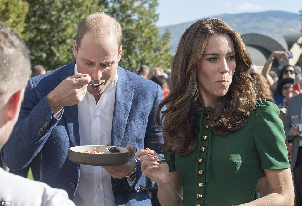 Kate looks a little unsure as she samples one local dish - although William seems more than happy to give it a try