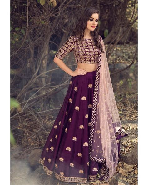 Stunning wine color designer lehenga and blouse with net