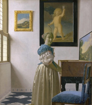Young Woman standing at a virginal