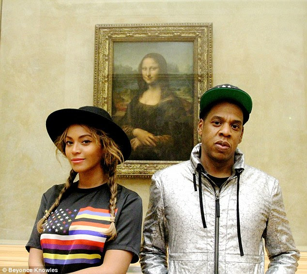1413128016021_wps_52_Beyonc_Knowles_and_Jay_Z_