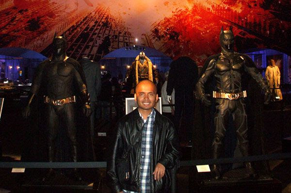 Posing with the Batsuits of THE DARK KNIGHT Trilogy, on December 7, 2012.