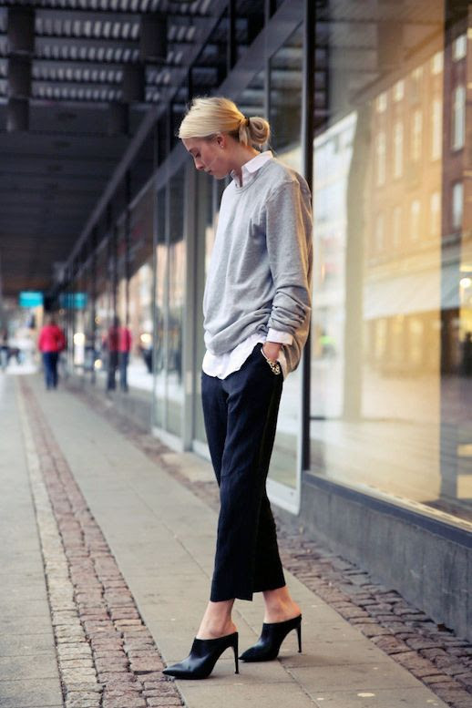 LE FASHION BLOG CLASSIC COZY CHIC MODERN DAY CAROLYN BESSETTE-KENNEDY BLOGGER STYLE ELLEN CLAESSON BLONDE HAIR LOW BUN WHITE BUTTON UP SHIRT LAYERED UNDER GREY GRAY SWEATSHIRT KNIT SWEATER SILVER CHAIN BRACELET KNOT BRACELET STACK BLACK SILK SATIN CROPPED PANTS TROUSERS TOPSHPOP GABI BLACK MULES HEELS 1 photo LEFASHIONBLOGCLASSICCOZYCHICMODERNDAYCAROLYNBESSETTE-KENNEDY1.jpg
