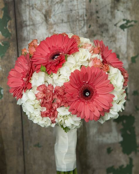 Coral gerbera, carnations and spray roses with a