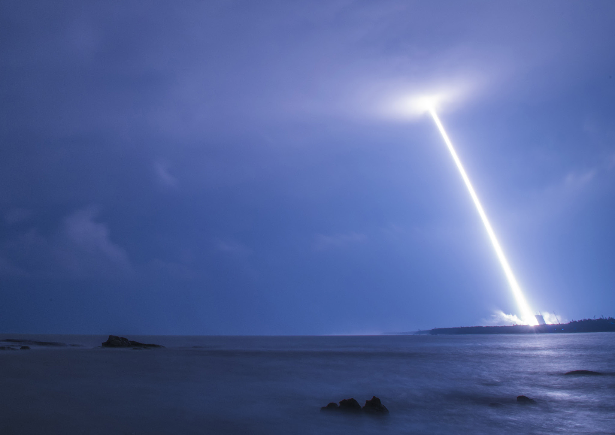 Blast trail of China's heavy-lift rocket Long March-5 as it launches from Wenchang, south China's Hainan province.