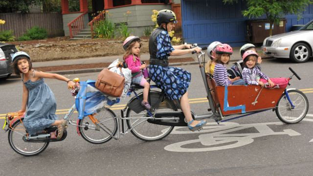 Pedal power: Emily Finch does the school run on a modified bicycle that can carry all SIX of her children