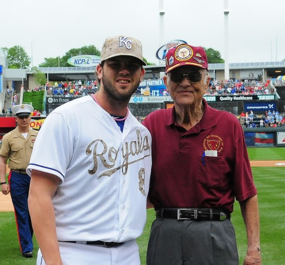 CM Sgt, Retired Charlie Sibert also threw out a first pitch.  The World War II veteran posed for a picture with his catcher, third baseman Mike Moustakas.