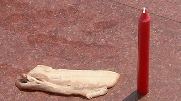 Calor bate recorde, e chineses fritam carne na calçada (Foto: BBC)