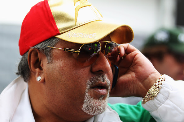 Vijay Mallya Force India Chairman Vijay Mallya walks in the paddock during the Australian Formula One Grand Prix at the Albert Park Circuit on March 28, 2010 in Melbourne, Australia.