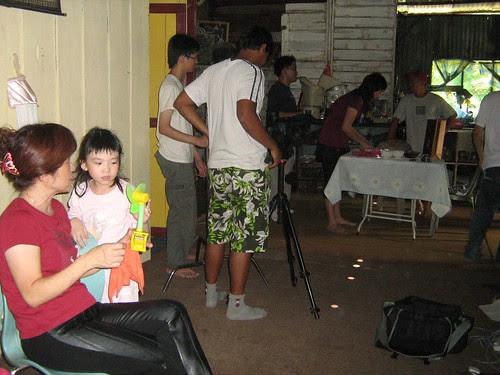 Li Hui needs the fan while we prepare the set.