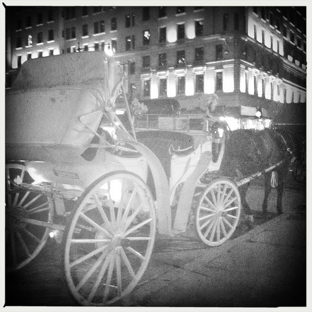 59th Street. Horse carriage, night
